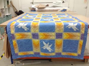 A colourful Blue and Yellow Oakleaf Quilt
