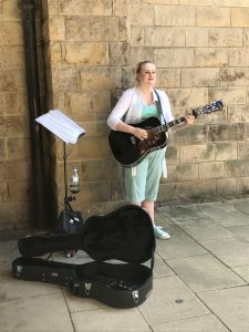 Busker, Ami Leigh Boorman on acoustic guitar