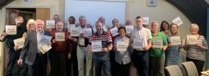 Group photo of Town Team members holding the Love Bishop Auckland cards; #LoveBishopAuckland